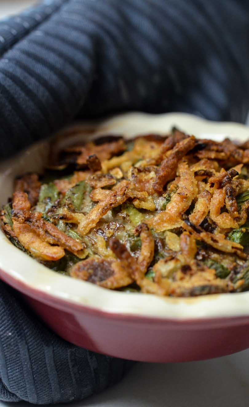 Green bean casserole served with hot mitts.