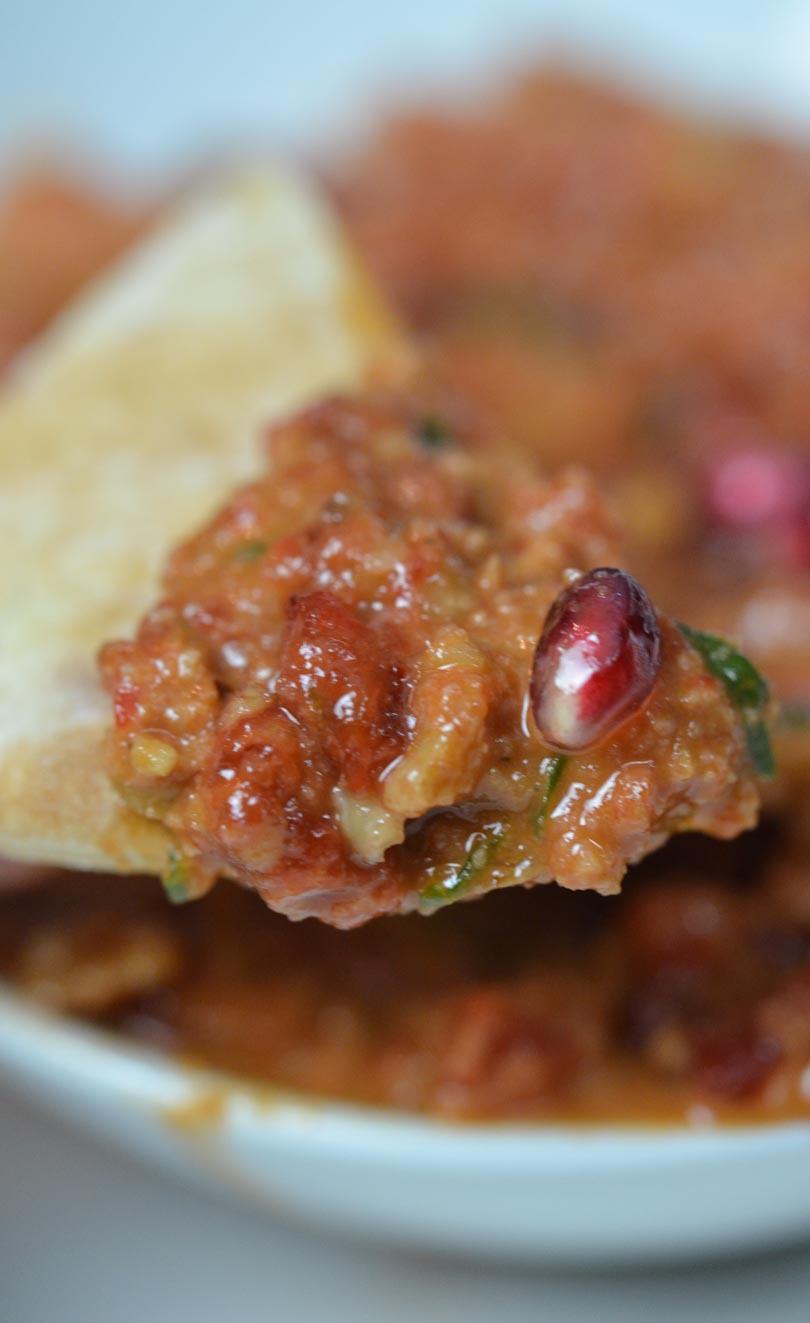 A pita chip full of muhammara.