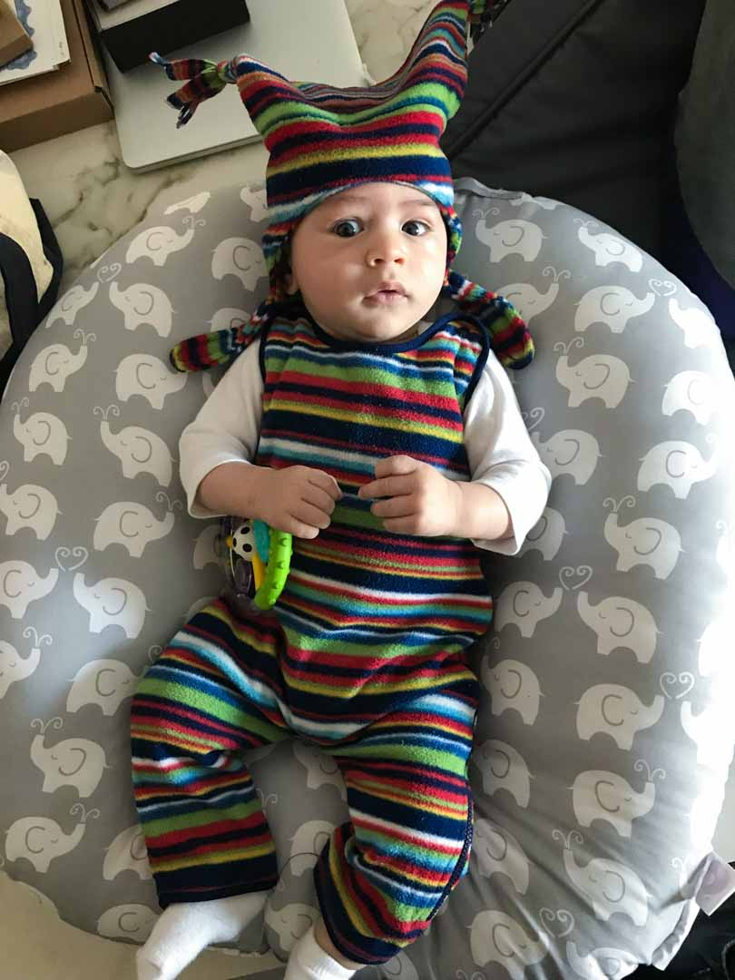Baby colorful and striped clothing and hat.