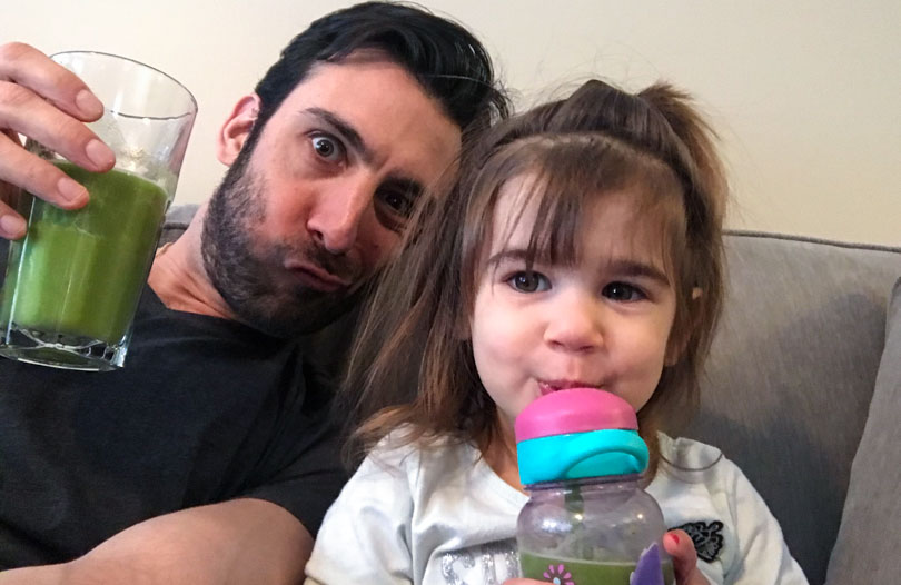 Lenny and Lena drinking green juice.