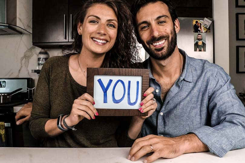 "Shalva and Lenny Gale with ""you"" sign"