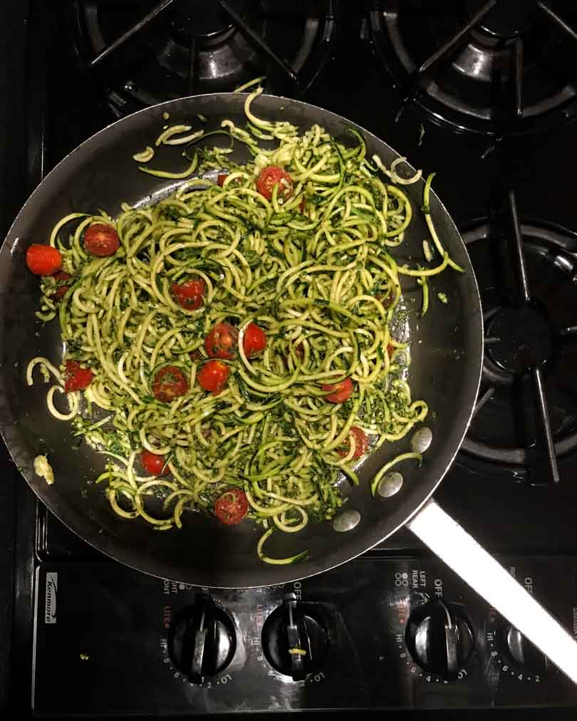 Zucchini noodles with pesto and tomatoes.
