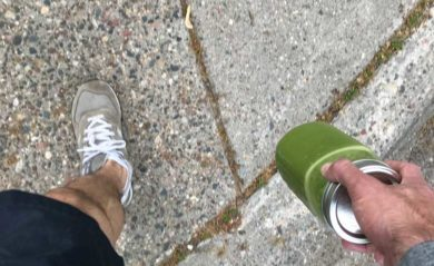 Lenny Gale walking with green juice in a mason jar.
